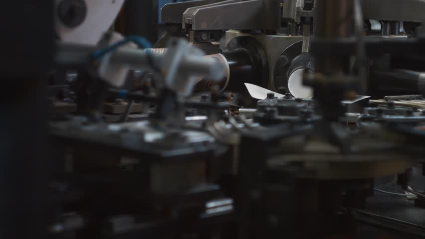 Modern automated equipment for production of paper cups. Manufacture of disposable tableware from environmentally friendly recyclable materials. Work on high performance and precision machinery | Shutterstock HD Video #1014944002