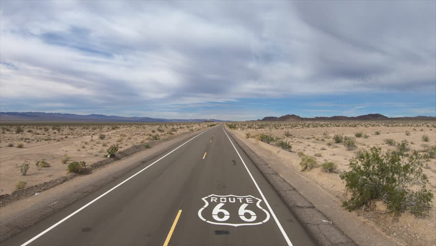 Aerial fly over of historic Route 66 pavement sign in the scenic California Mojave desert. | Shutterstock HD Video #1014960292
