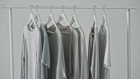 Clothes are swinging on hanger