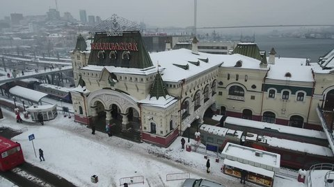 Helicopter Side Railway Station snow Blizzard. Vladivostok Russia. Train historical monument decor symbol Trans-Siberian Railway Port horn Cityscape Landmark Travel people walk. Winter overcast. Drone