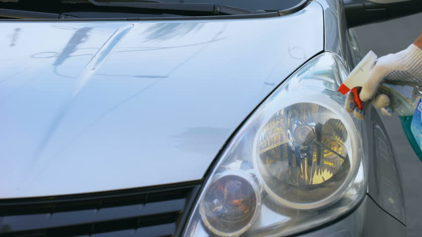 Man Cleaning Headlights On Auto Stock Footage Video 100 Royalty