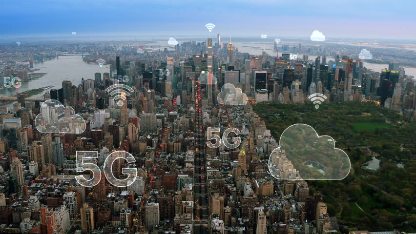 Aerial city connected through 5G. Wireless network, mobile technology concept, data communication, cloud computer, artificial intelligence, internet of things. New York City skyline. Futuristic city.