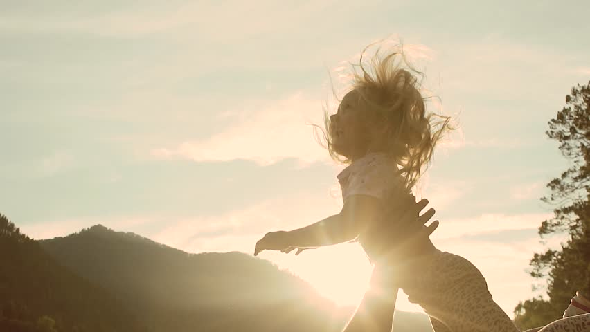 Slow motion of handsome father throwing his adorable daughter in the air | Shutterstock HD Video #1015073542