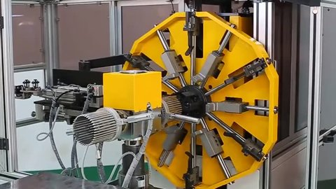 Industry Electric Motor Production.Transformer, engine production. Worker operates with electric cooper wires, winding of the transformer. HD.