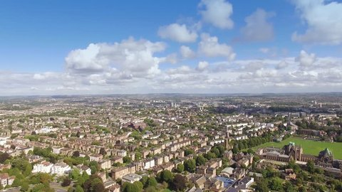 Aerial flyover green tree lined city streets of Bristol, England, drone shot