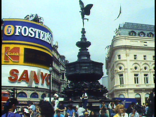LONDON, ENGLAND, 1988, Piccadilly Circus, wide shot, Eros Statue, traffic people