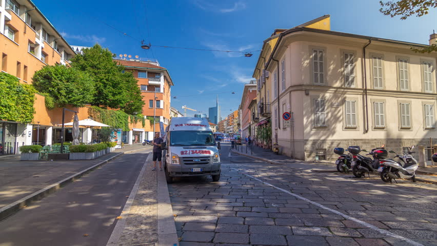 The street with ancient buildings in the center of Milan timelapse hyperlapse, Italy. Fast walk at Brera district | Shutterstock HD Video #1015242322