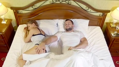Top view of upset lying sleepless couples. a man can't get aroused. health problems impotent