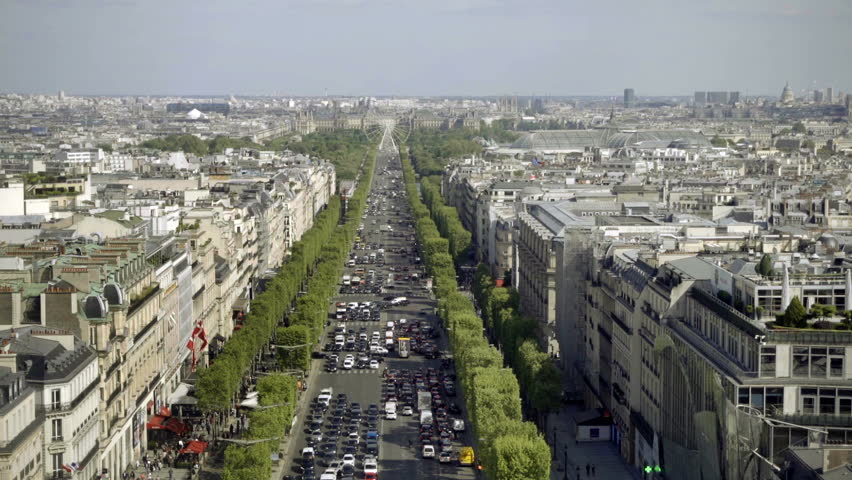 PARIS - MAY 3, 2018: Champs-Elysees avenue with cars stuck in traffic - bumper to bumper on tree-lined street in Paris France Europe. The Champs-Élysées ends at the Arc de Triomphe. | Shutterstock HD Video #1015273162