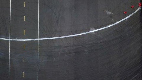 Aerial view 4k footage professional driver drifting car on asphalt race track, Drifting car 4k.