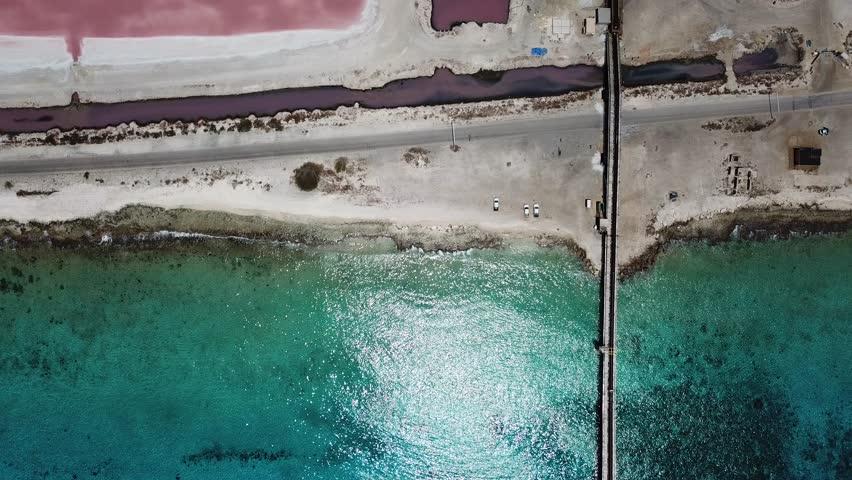 Rose caribbean salt lake Bonaire island aerial drone top view 4K UHD video  | Shutterstock HD Video #1015377502