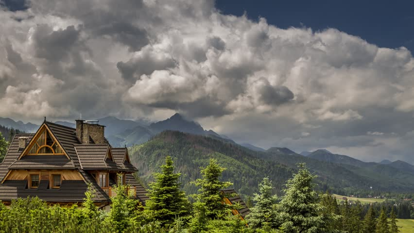 Stormy clouds over cottage in Tatra Mountains in summer, Zakopane, Poland