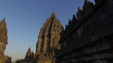 Forward dolly shot of Candi Brahma, Wisnu, and Siwa as three main temple in Prambanan Temple