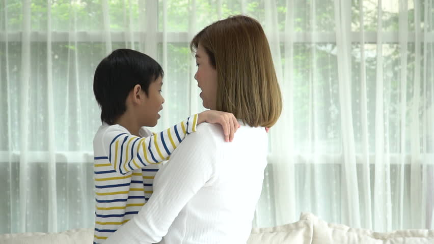 Asian child huging his mother with love at home slow motion #1015476382