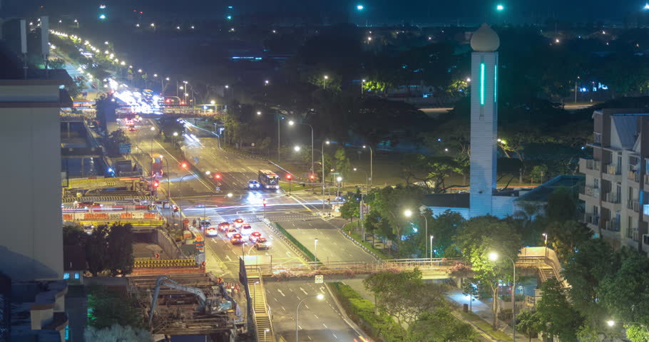 Traffic signal cars stopping and moving timelapse video clip at night, Singapore