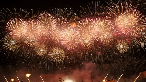 Spectacular fireworks in 4K. New Year celebration colorful fireworks. New year and holidays concept.