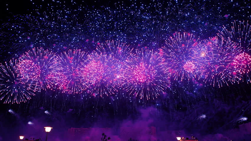 Spectacular blue firework display. New Year celebration colorful fireworks 4k. New year and holidays concept.    Shutterstock HD Video #1015515562