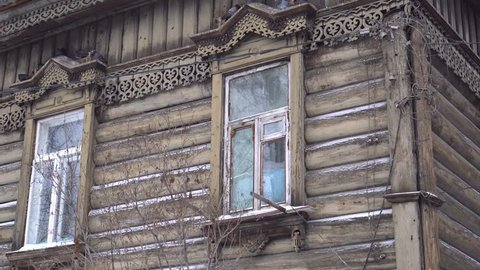 Cold Siberian winter wooden old house. Unique authentic Russian style wood carving architecture. Irkutsk center tourist attraction. White snow wind blizzard. Gimbal professional 4k