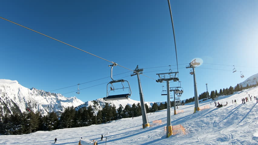 Intersection of ski lifts. Chairlift POV going up a ski resort in Bansko, Bulgaria
