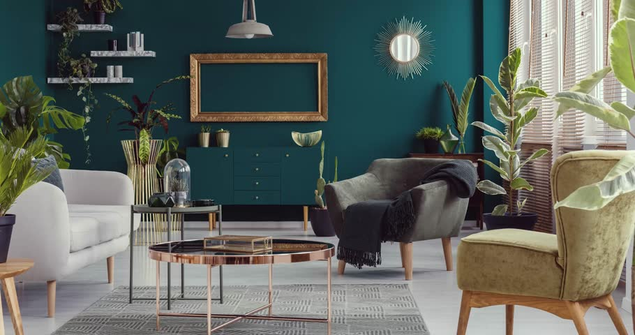 Video of green living room interior with plants with furniture like copper table, armchairs and sofa disappearing