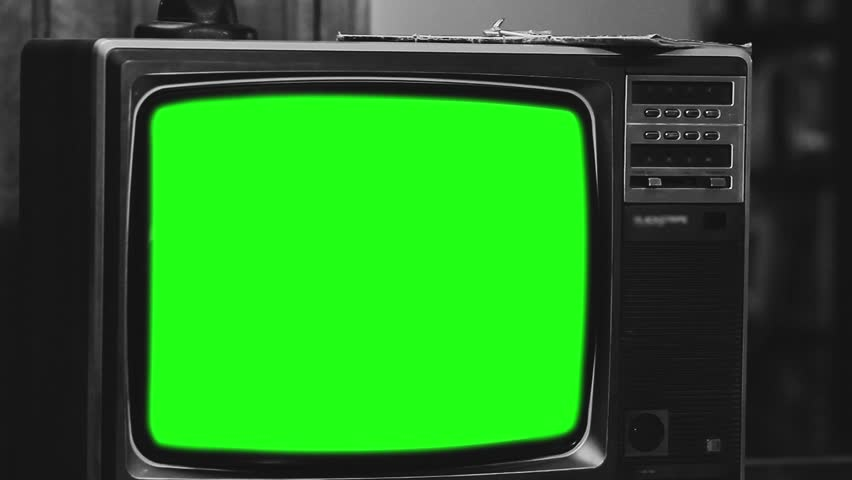 "Old 1980s TV with Green Screen. Black and White Tone. Zoom Out. Ready to Replace Green Screen with any Footage or Picture you Want. You Can Do It With ""Keying"" (Chroma Key) Effect.   