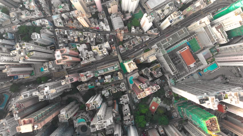 Aerial drone shot of congested building area of Hong Kong city and traffic | Shutterstock HD Video #1015702522