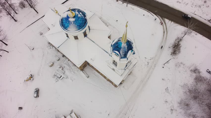Sunset winter forest near the river, aerial view of the old church, aerial view. Clip. Aerial view on old white Christian church near the river with blue roof | Shutterstock HD Video #1015714372