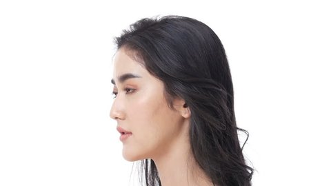 Beautiful Asian Woman Portrait. Beautiful Woman looking to camera. Korean Woman Touching her Face. People with Youth and Skin Care Concept.