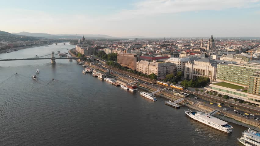 Budapest / Hungary - August 24, 2018: Aerial drone wide angle footage showing Chain Bridge, the Parliament and Deak Ferenc Square | Shutterstock HD Video #1015759972