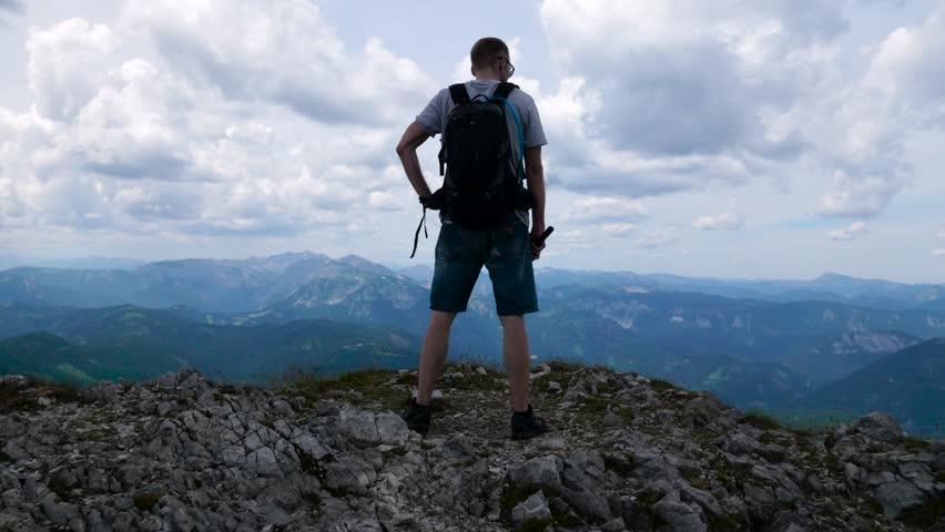 Man on the edge of mountine #1015775062