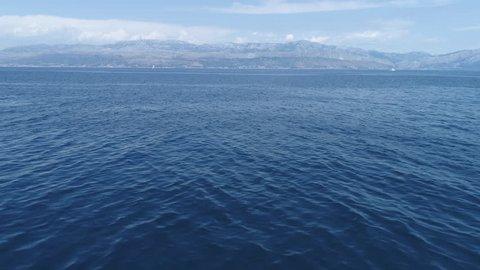 Flight over ocean, open sea. Dynamic aerial shot, after camera tilt - Mediterranean sea