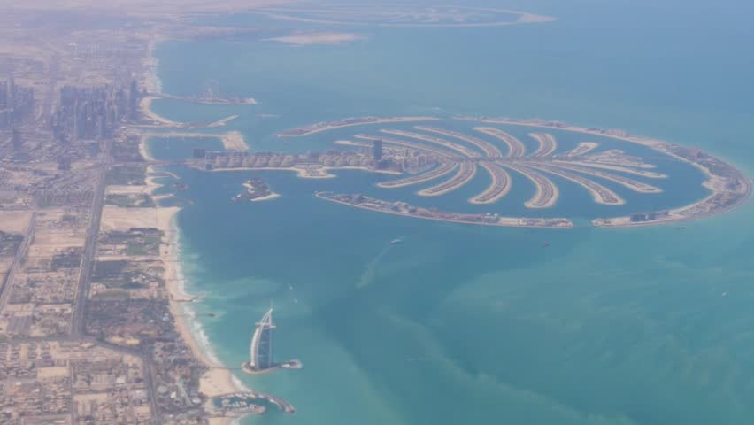 Aerial view of Palm Jumeirah, Dubai. A beautiful set of islands made by man shaped as a huge palm tree.