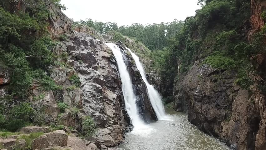 Close approach of wild waterfall in Africa. Manzini, Swaziland. The Heads of Knysna.