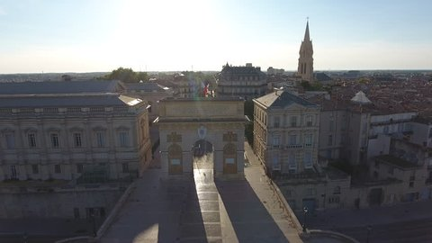 Drone flying through the Arc de Triomphe in Montpellier. One of the gates of the city's old ramparts. Sunny day France