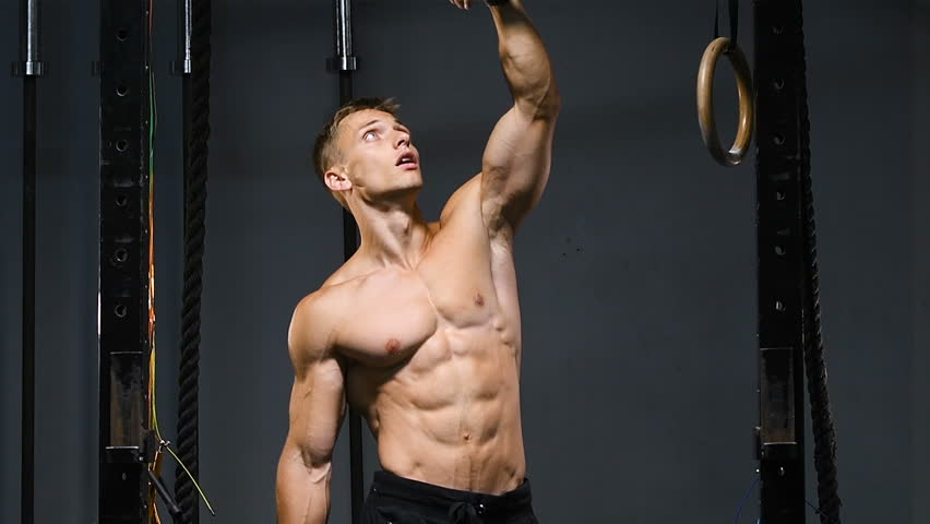 84722c448a6 strong bodybuilder muscular athletic man with jump rope and gymnastic rings pumping  up muscles workout bodybuilding concept background - muscular ...