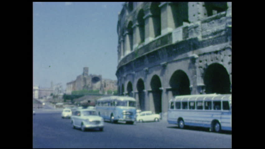 Colosseum exterior shot, Rome, Italy 1950's. Also a shot of traffic and old square. 8mm vintage film footage.