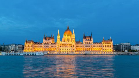 Budapest Hungary time lapse 4K, city skyline night timelapse at Hungarian Parliament and Danube River