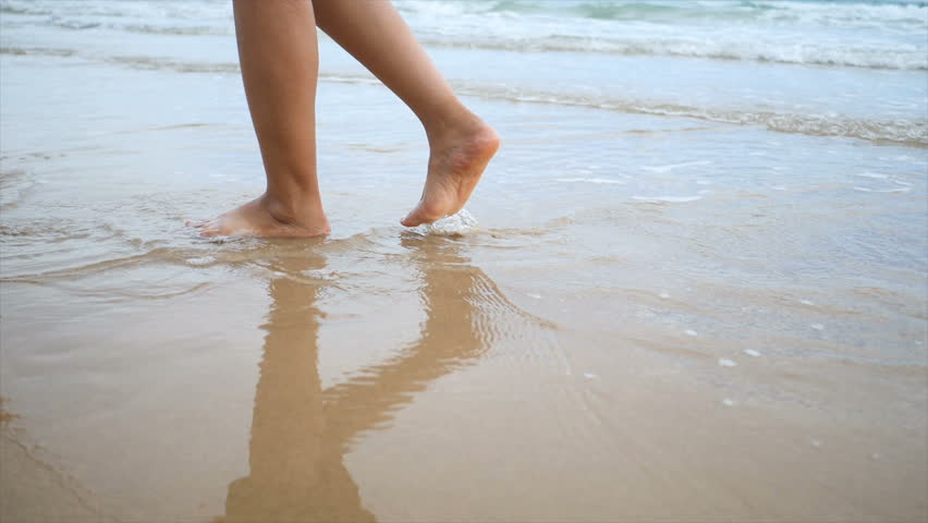 Slow motion woman feet walking on the sand beach with nature sea wave coast for summer vacation concept | Shutterstock HD Video #1015882012