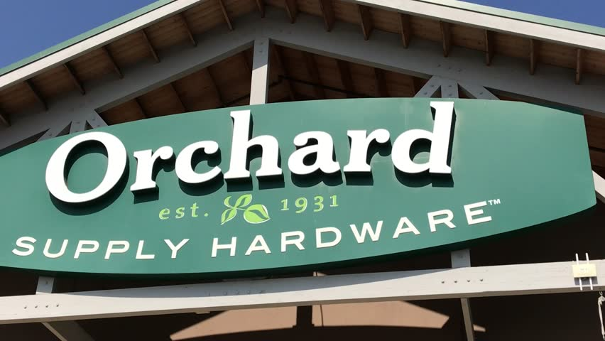 LOS ANGELES, Sep 1,2018: Close up of an OSH Orchard Supply Hardware store sign and logo above a West LA store, then pan down to entrance and customers entering store that is surrounded with sale signs