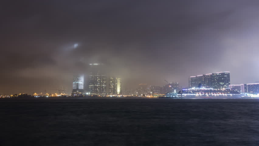 Night sea traffic on a foggy night at Victoria Harbour in Hong Kong