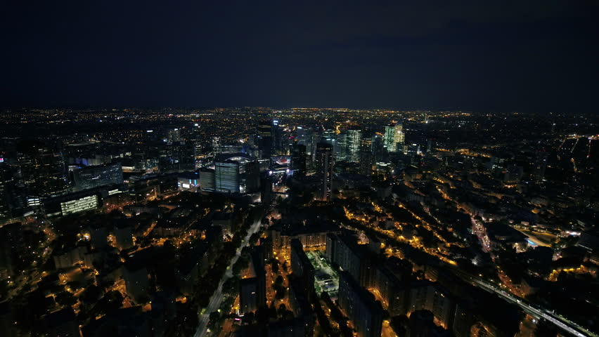 Aerial France Paris Financial District August 2018 Night 30mm 4K Inspire 2 Prores  Aerial video of the financial district in Paris France at night. | Shutterstock HD Video #1015903342