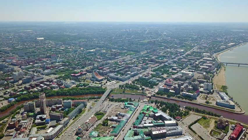 The merger of the Irtysh and Om rivers, panoramic views of the city. Omsk, Russia, From Dron