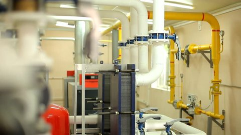 Pipes and Meters in the Boiler Room in an Industrial Plant