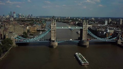 Aerial view of the iconic landmark that is Tower Bridge which crosses the river Thames in London London Business Center can also be seen