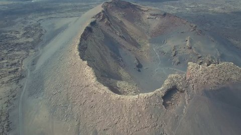 Beautiful volcanic landscape and crater on the island of Lanzarote, aerial drone video footage