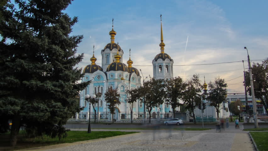 Orthodox temple of saint Alexander in city Kharkiv (Ukraine) timelapse. Church in a summer day on a blue cloudy sky background.