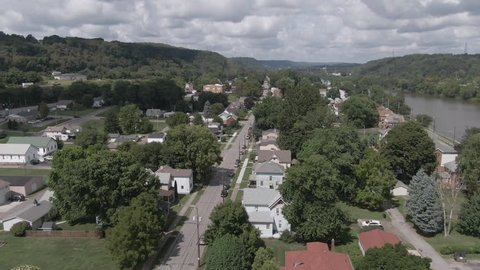 A summer aerial establishing shot of the residential district of a small Pennsylvania town. Pittsburgh suburbs.