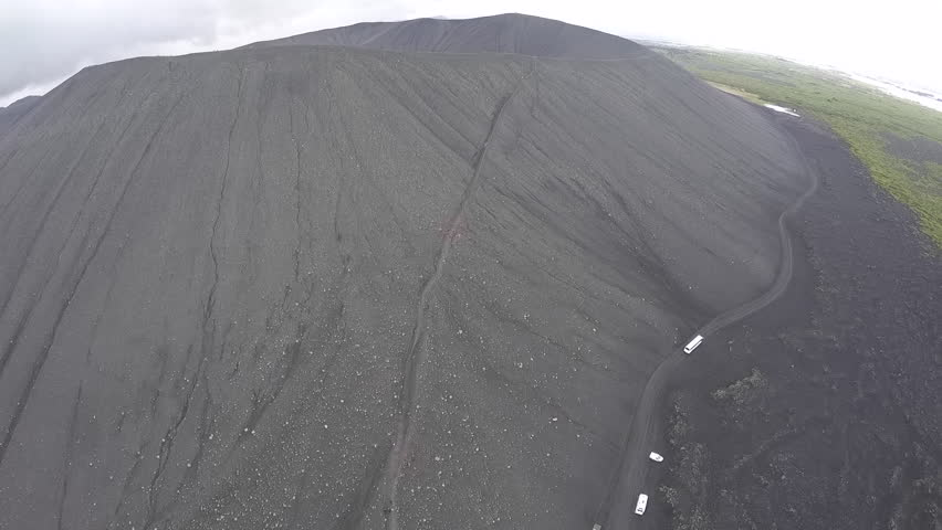 Hverfjall (also known as Hverfell) is a tephra cone or tuff ring volcano in northern Iceland, to the east of M_vatn.