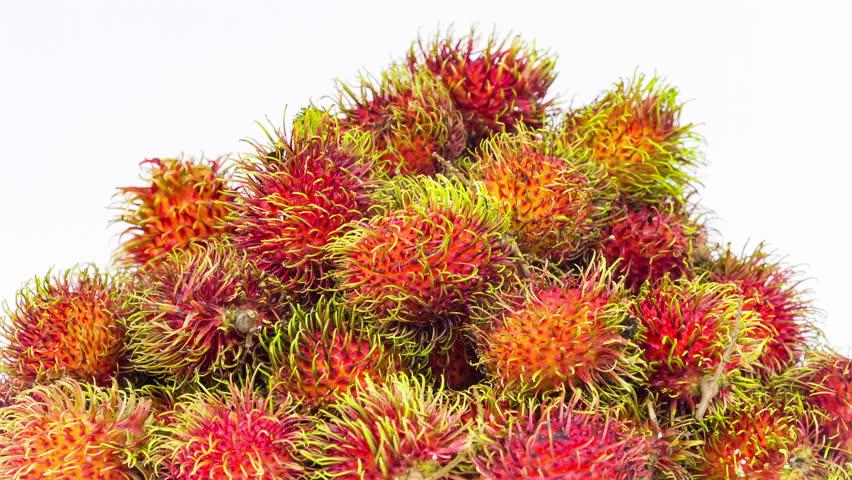 Mountain of tropical fruit of rambutan rotation on white background