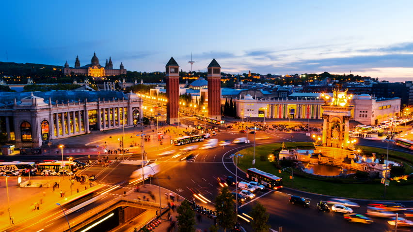 Barcelona, Spain. Spanish Square aerial view in Barcelona, Spain at night. Time-lapse of traffic light trails, fountain and Venetian towers, National museum at the background. Colorful sky | Shutterstock HD Video #1016123212